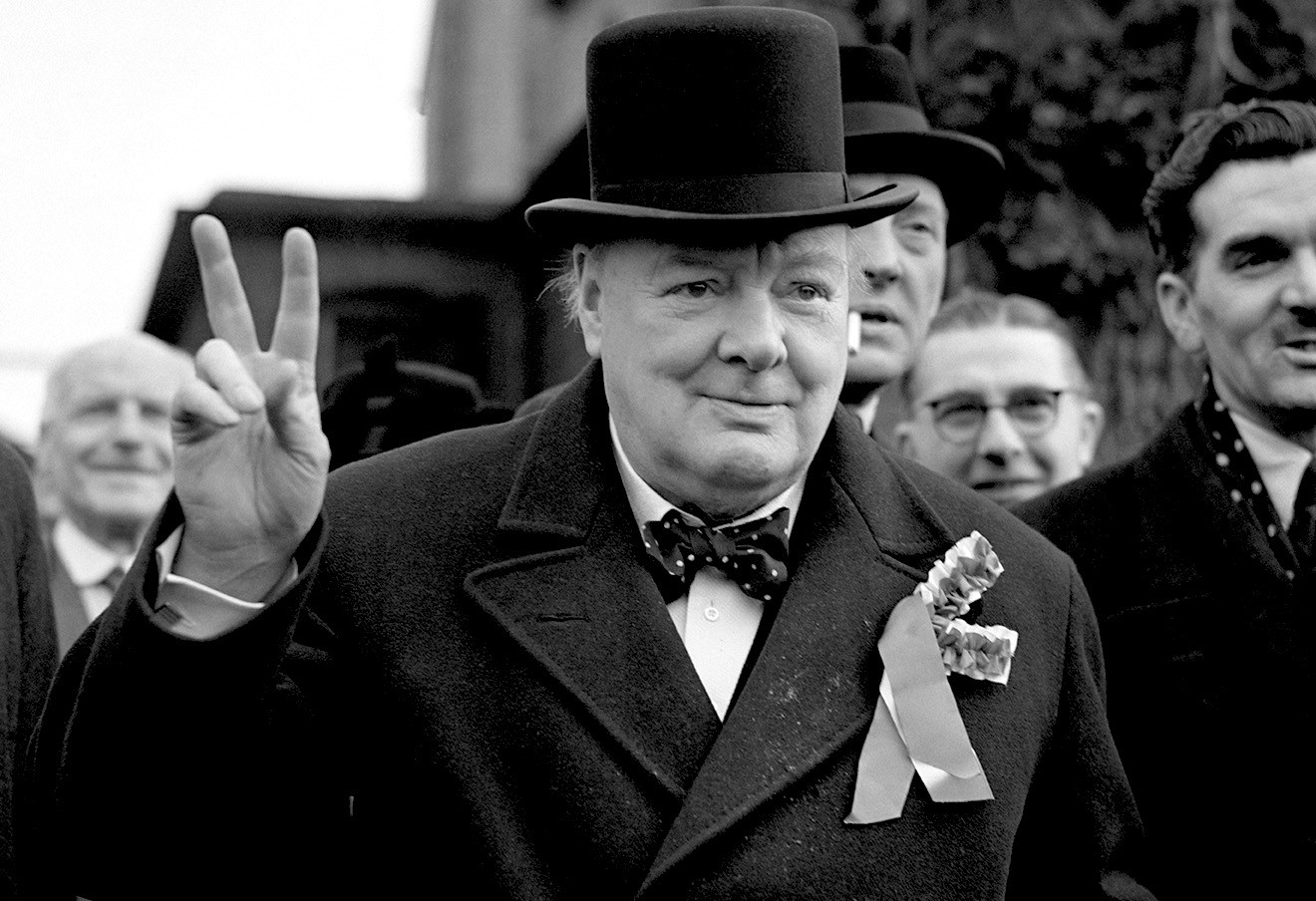 Mr Winston Churchill give his 'victory' sign as he made a general election polling day tour of his constituency - Woodford, Essex.